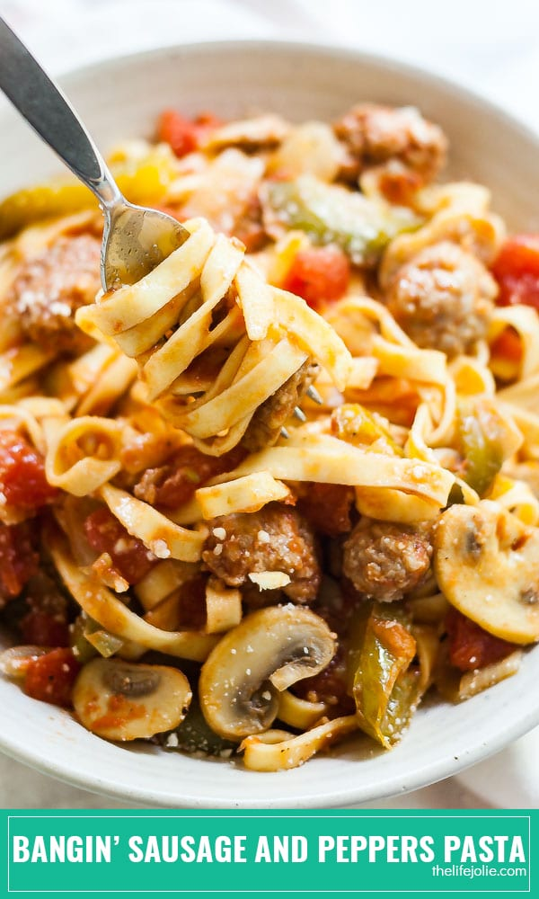 This Sausage and Peppers Pasta recipe is such an easy dinner! Sausage, peppers, onions, mushrooms and garlic combine with diced tomatoes and white wine to make a simple Italian meal. This is a delicious, quick weeknight dinner for families and a great date night meal for couples!