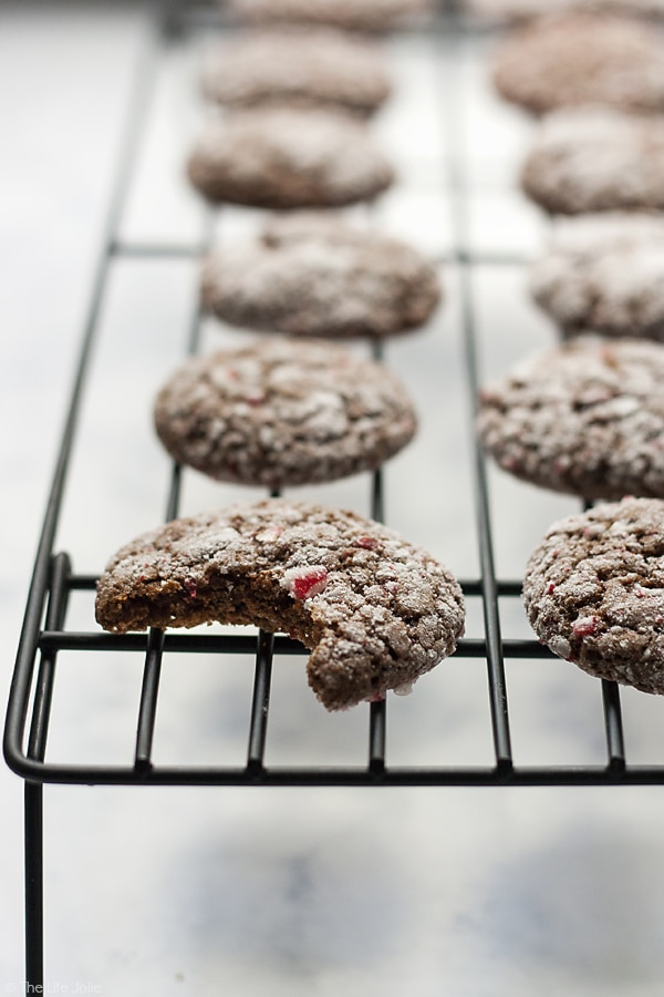 These Chocolate Peppermint Crinkles are an easy way to add a fun spin to a traditional recipe. These cookies are chewy and fudgy but they also have a delicious mint flavor. They are the best Christmas cookie for kids to make and eat!