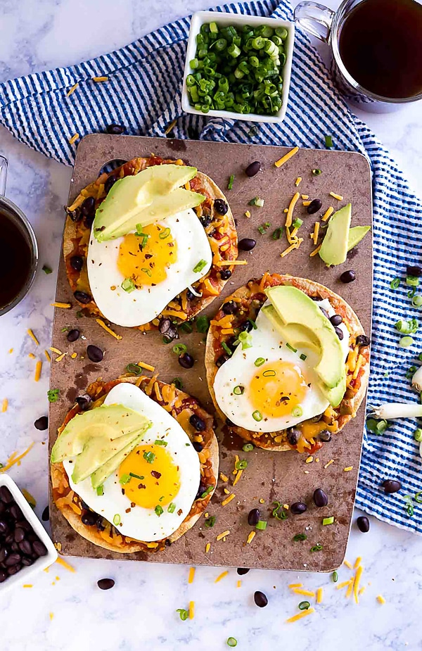 Baked Breakfast Tostadas are one of my favorite easy recipes to make for breakfast (or lunch- or brunch!). This is simple cooking at it's finest with corn tortillas, salsa, black beans, cheese and eggs. You can get creative and take it in whatever direction you'd like- this quick and delicious dish is definitely a keeper!