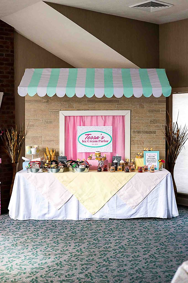 This DIY Awning and table backdrop a simple and fun way to decorate a dessert bar at your next party or event. The background and awning are pretty easy to make and you can click on the photo to get full directions and plans to make this from start to finish! Your guests will be wowed!