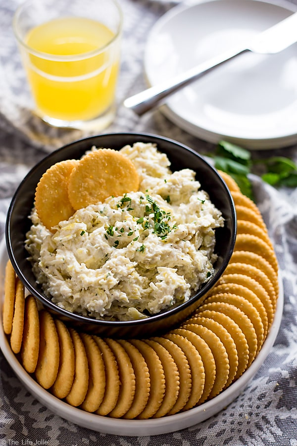This Artichoke Asiago Dip is the best easy recipe to throw together for a last-minute spring get-together. It only takes a couple of minutes to make and is fully of cheesy, delicious flavor! #ad