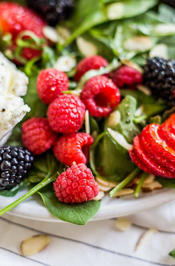 A close up of the raspberries in the Summer Berry and Burrata Salad.