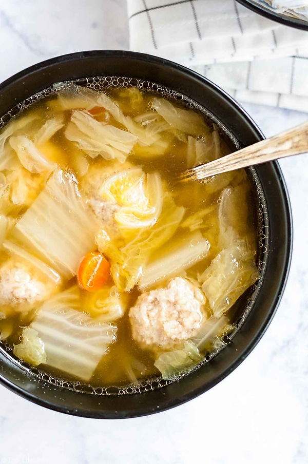 An overhead shot of Cabbage and pork meatball soup.
