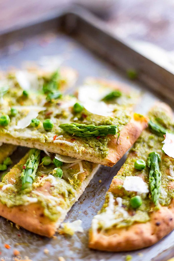 Slices of Pea Pesto Flatbread piled on top of each other.
