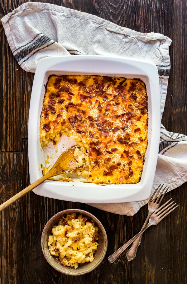 An overhead image of a pan of Bacon Ranch Creamy Macaroni and Cheese with a spoon sticking out of it.