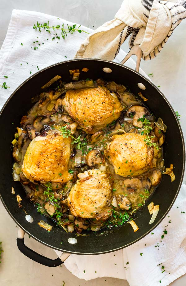 An overhad image of Champagne Braised Chicken Thighs in a pan.