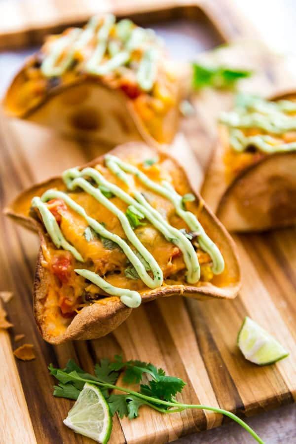 A close up of Cheesy Chicken Taco Bowls on a cutting board.