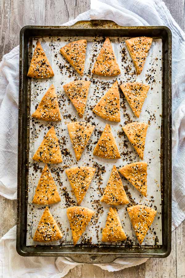 An overhead image of a pan covered with Everything Pita Chips.