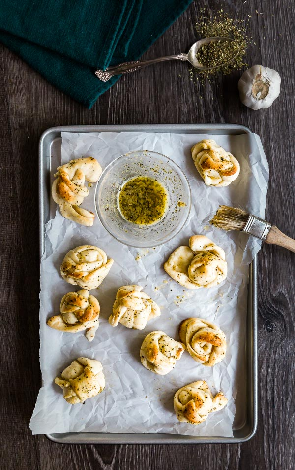 An over head shot of a pan of Cheesy Garlic Knots.