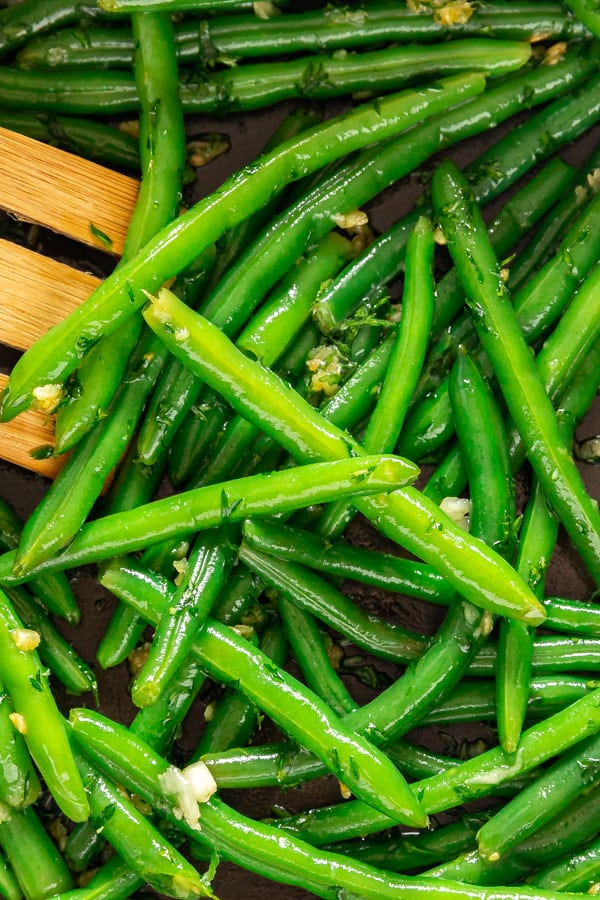A close up overhead image of sauteed green beans
